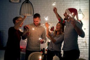 people celebrating christmas with sparklers