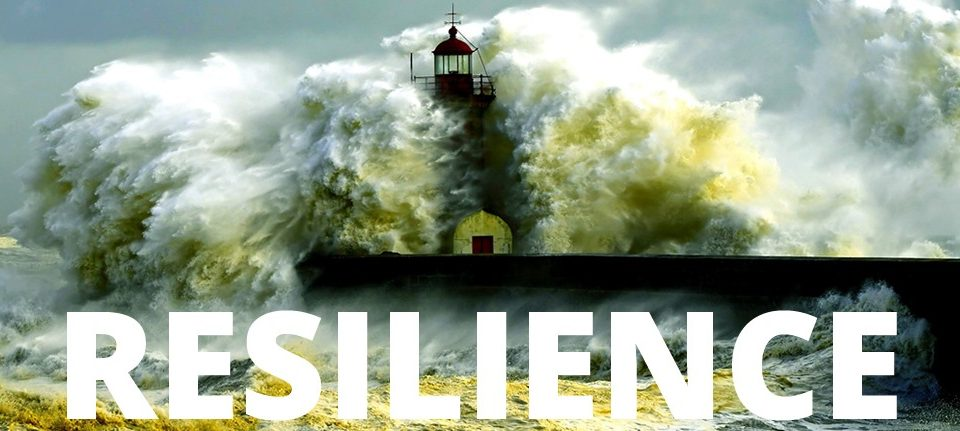 resilience text with lighthouse withstanding a storm
