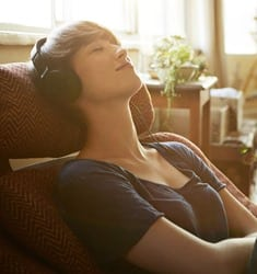 Woman relaxing with music
